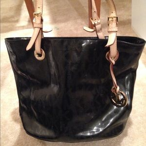 Michael Kors bucket black patent leather bag.